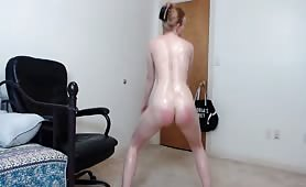 Oiled up big booty pale redhead twerking on cam